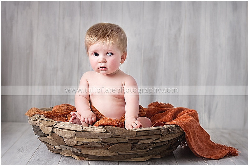 Baby in a basket using the Faux Wood backdrop