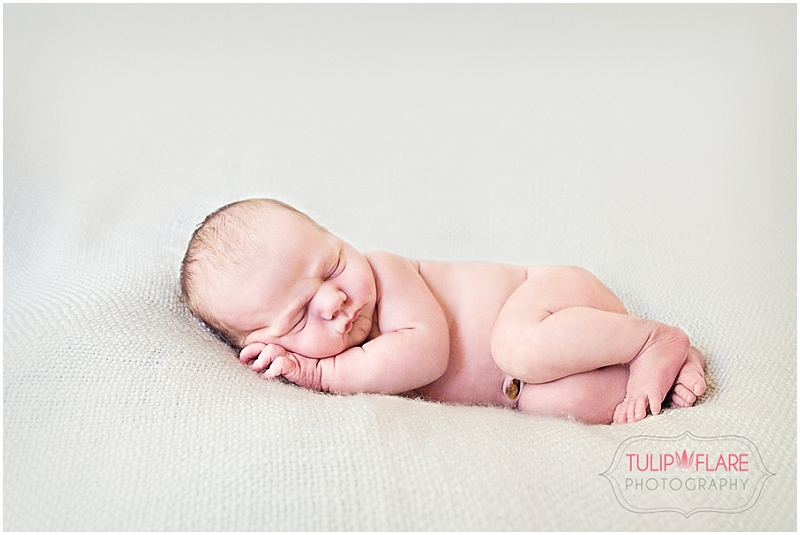 Side Lying pose for a newborn session