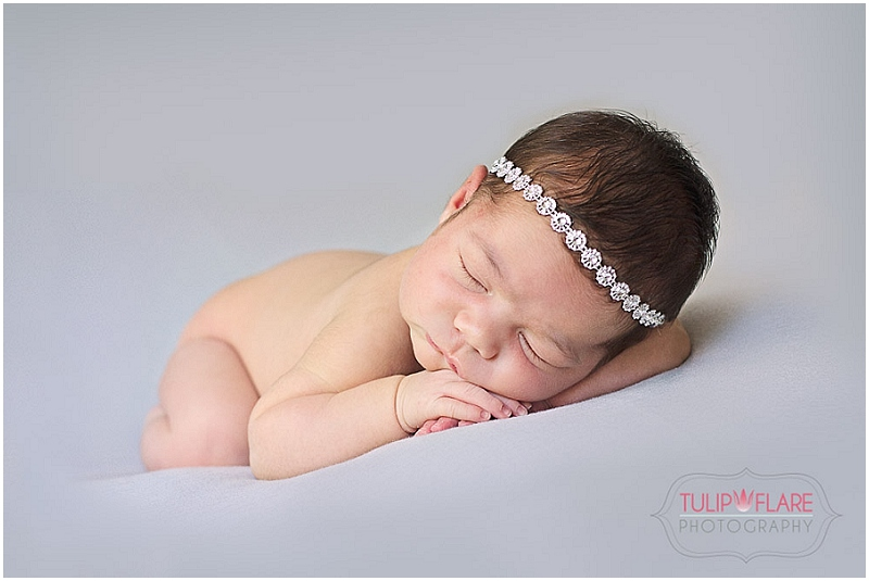 Newborn baby photograph using a head band with sparkle
